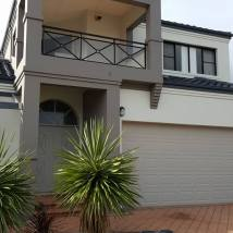 After | Full exterior repaint to a two storey beach side home