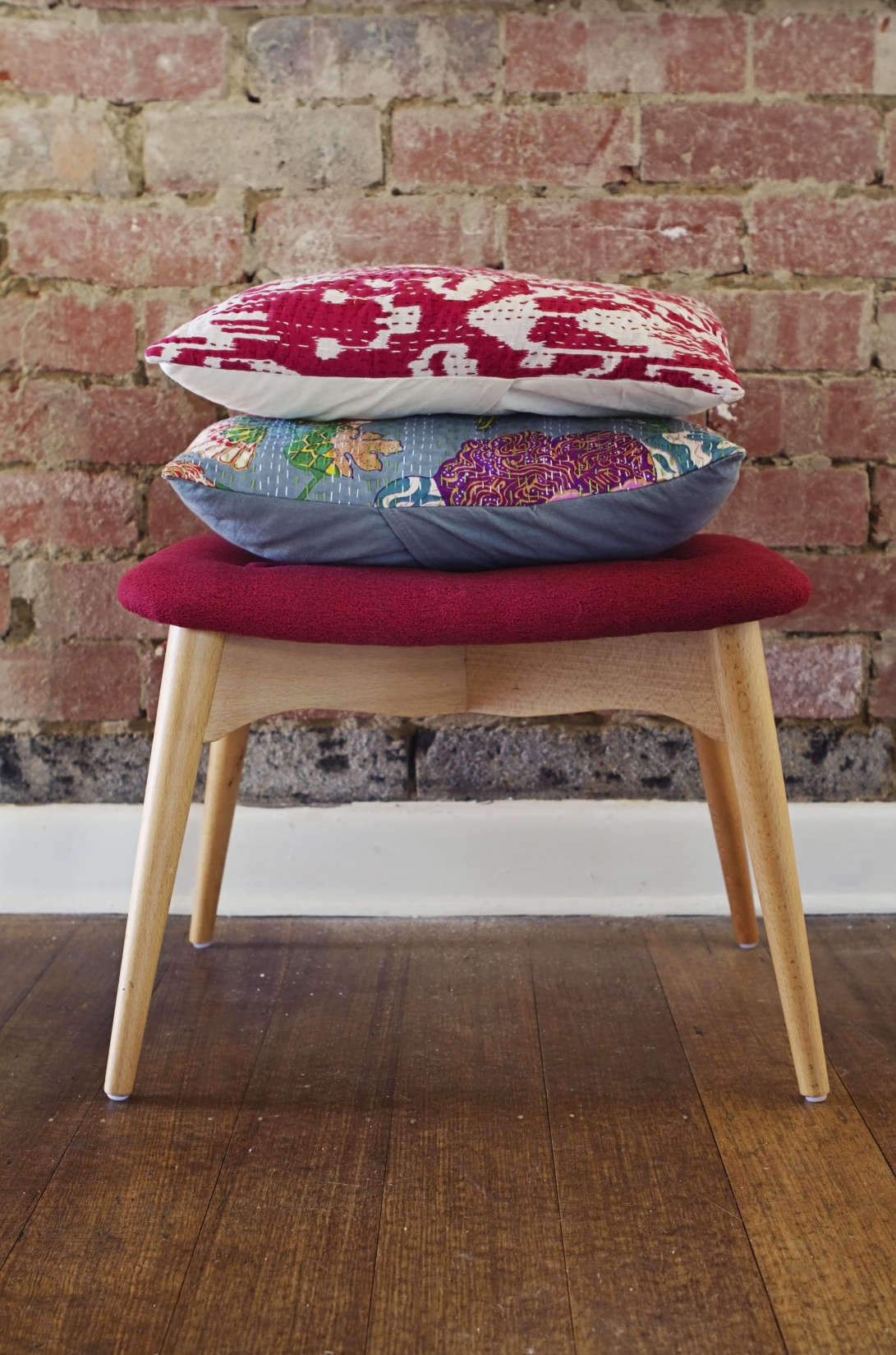 Homewares cushions on ottoman stool