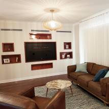 After | In built recessed wall with timber shelves, soft furnishings, lighting, furniture selection and painting